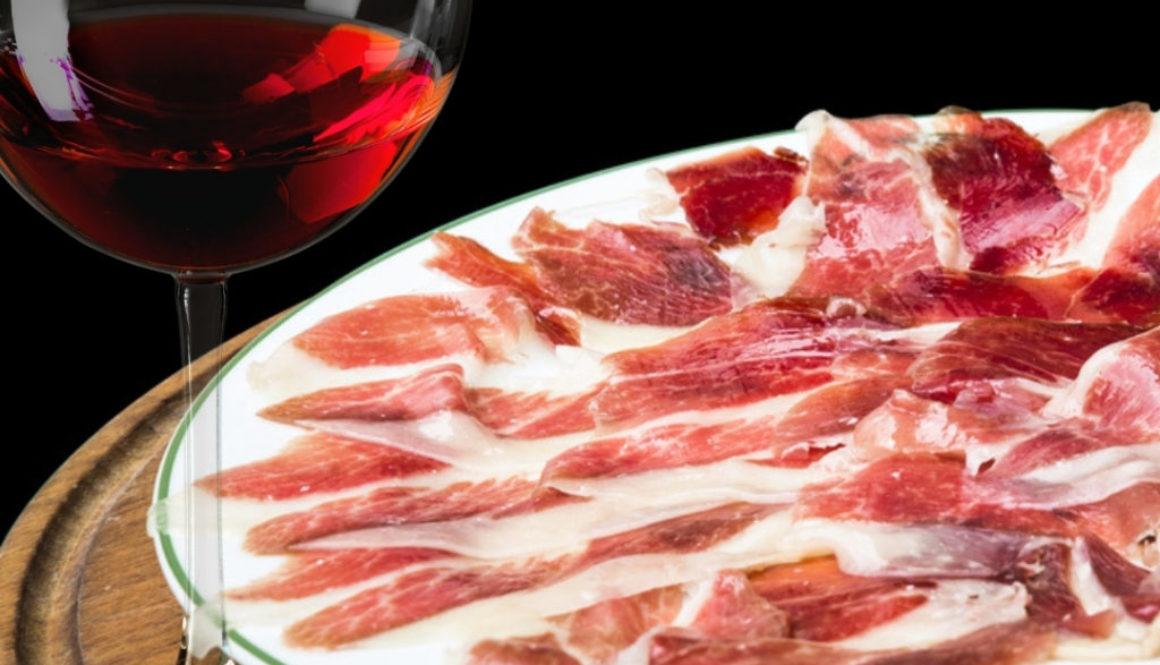 copa de vino y plato de jamón ibérico
